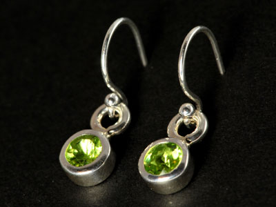 Stunning, handmade gem quality peridot drops set in pure silver.