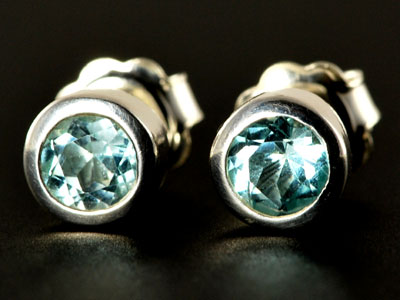 Stunning, handmade gem quality sky blue topaz studs set in pure silver.