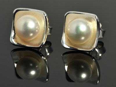 Beautiful white cultured pearl, cupped in a handmade bed of pure silver