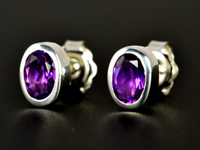 Stunning, handmade gem quality amethyst oval studs set in pure silver.